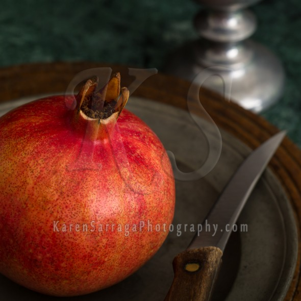 Red Pomegranate On A Pewter Plate | Stock Photo