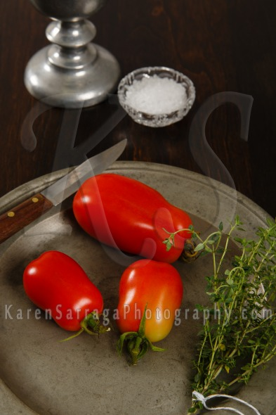 Plum Tomatoes On A Pewter Plate | Stock Photo