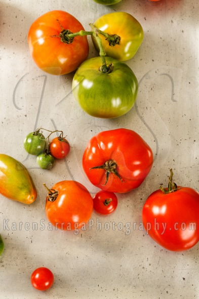 Overhead View Of Red And Green Homegrown Tomatoes | Stock Photo
