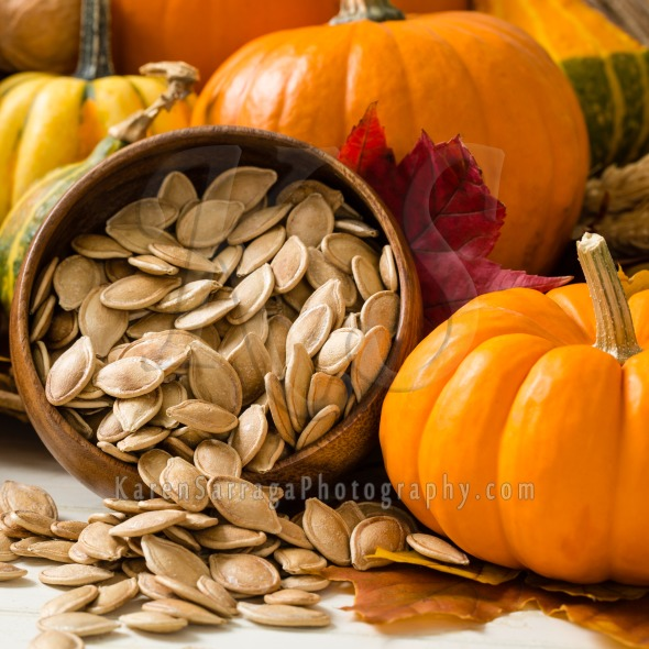 Orange Pumpkins With Toasted Pumpkin Seeds | Stock Photo