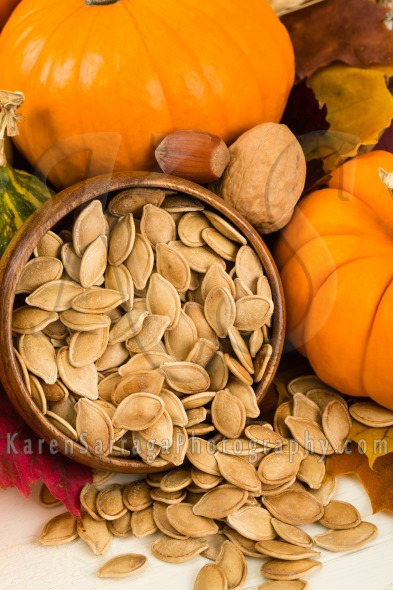 Toasted Pumpkin Seeds With Pumpkins | Stock Photo