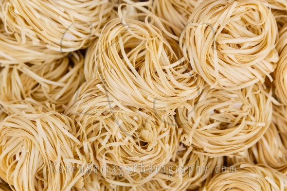 Overhead View of Coiled Flat Noodles | Stock Photo